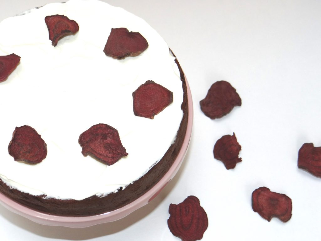 Beetroot and chocolate cake decorated with Nim's Beetroot crisps